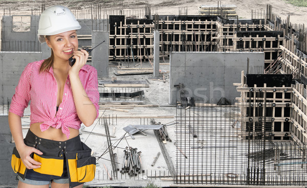Young woman in hard hat holding walkie talkie  Stock photo © cherezoff