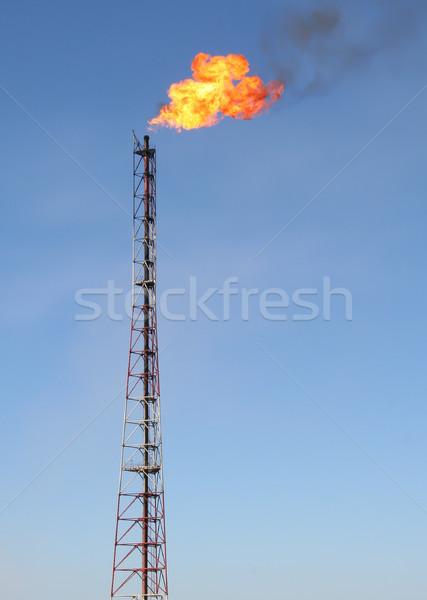 Gaz parlama yangın mavi gökyüzü Stok fotoğraf © cherezoff