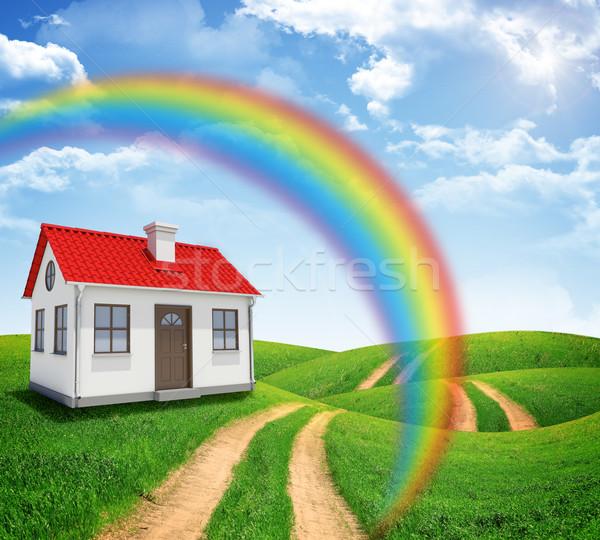 Casa verde campo arco iris carretera nubes Foto stock © cherezoff