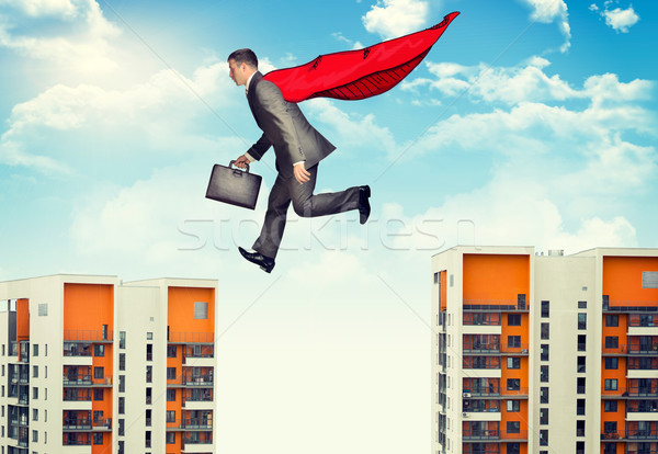 Affaires abîme valise nuages bâtiment Photo stock © cherezoff