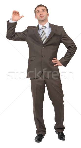 Businessman leans on empty space Stock photo © cherezoff