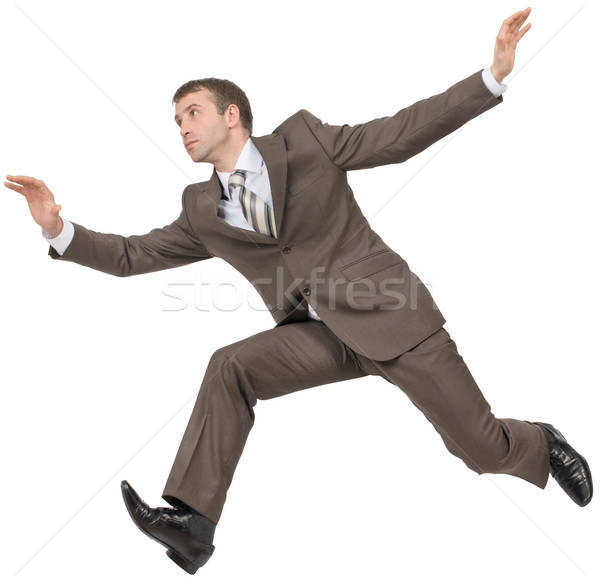 Businessman in suit running fast on white Stock photo © cherezoff