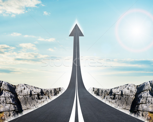 Road going up as an arrow in sky Stock photo © cherezoff