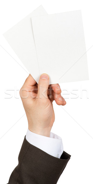 Businessman holding two small blanks paper Stock photo © cherezoff