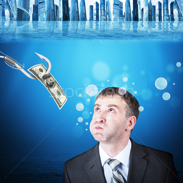 Businessman with inflated cheeks under water Stock photo © cherezoff