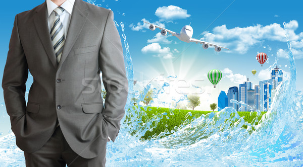 Businessmen with green grass, buildings and airplane Stock photo © cherezoff