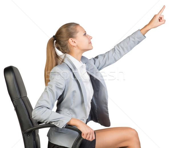 Işkadını ofis koltuğu işaret parmak yukarı önde Stok fotoğraf © cherezoff