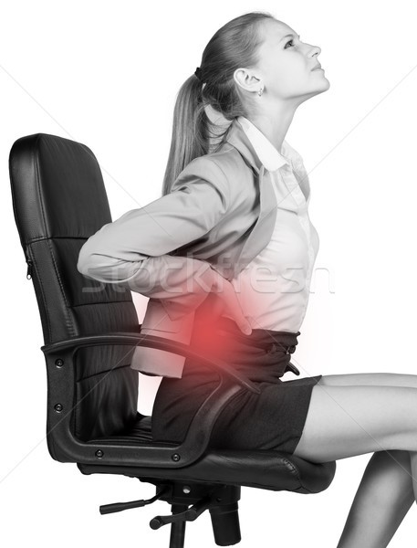 Businesswoman with lower back pain, sitting on office chair Stock photo © cherezoff