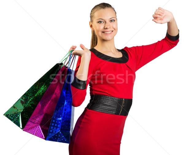 Woman with teeth smile handing three bags  Stock photo © cherezoff