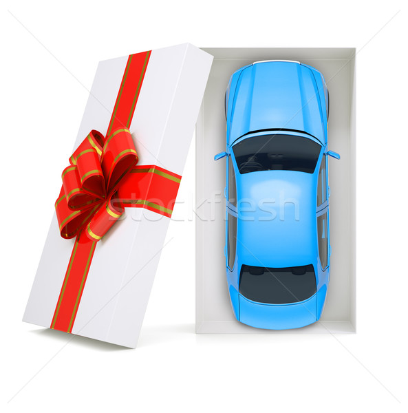 Car in gift box on white, top view Stock photo © cherezoff