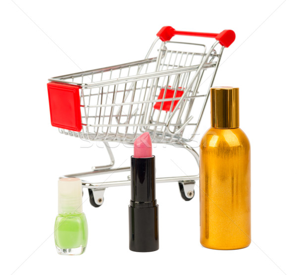 Shopping cart with nail polish and perfume Stock photo © cherezoff