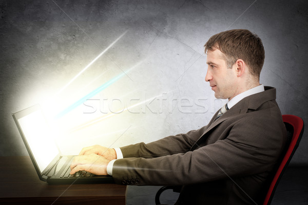 Businessman with laptop. E-business concept Stock photo © cherezoff