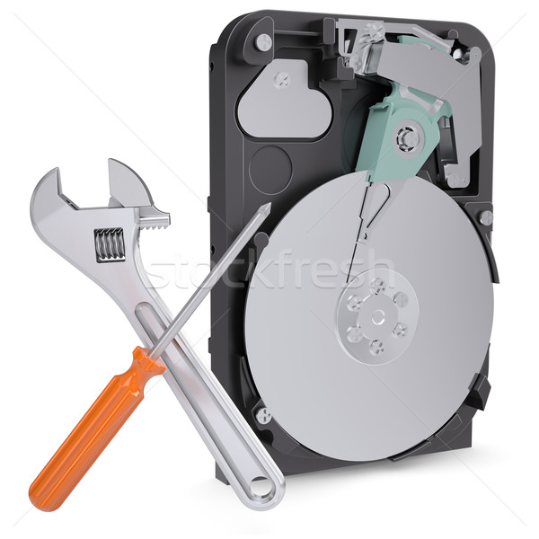 Screwdriver, wrench and disclosed hard drive Stock photo © cherezoff