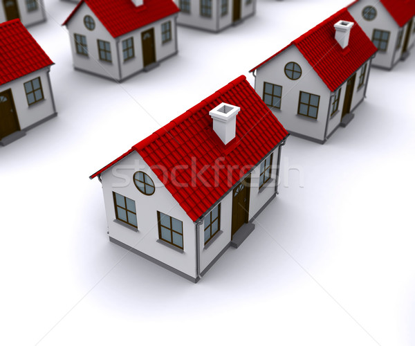 Group of houses with red roofs. Depth of field in the first house Stock photo © cherezoff