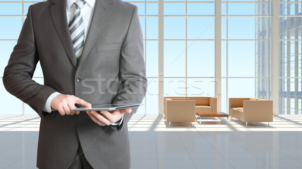 Businessman with tablet in office building Stock photo © cherezoff