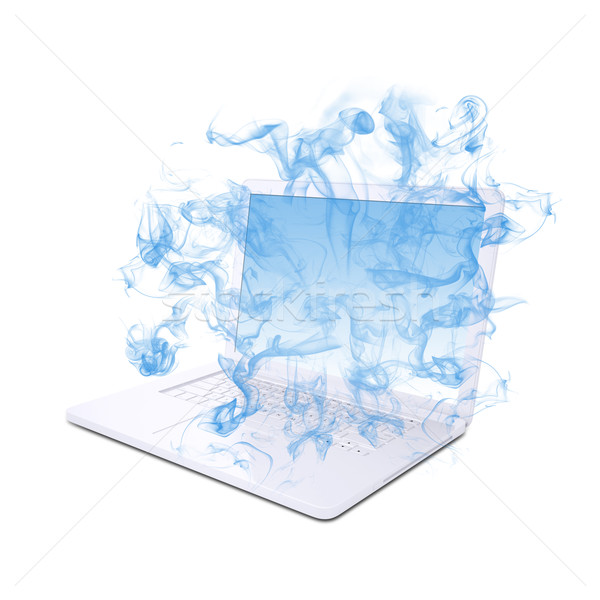 Open white laptop emits blue smoke Stock photo © cherezoff