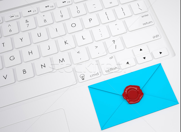 Envelope with stamp on the keyboard Stock photo © cherezoff