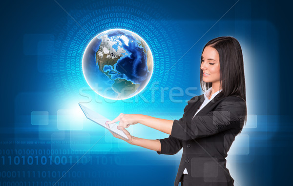Nők digitális tabletta Föld átlátszó gyönyörű Stock fotó © cherezoff