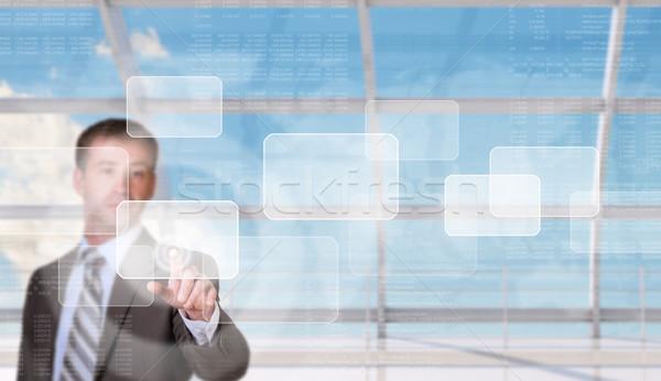 üzletember kisajtolás holografikus képernyő számok ablak Stock fotó © cherezoff