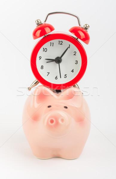 Alarm clock on piggy bank Stock photo © cherezoff