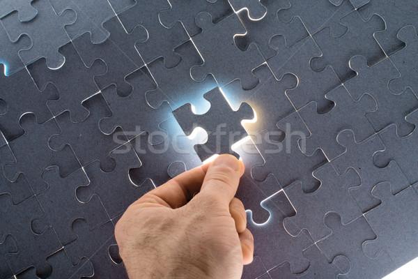 Man holding puzzle piece Stock photo © cherezoff