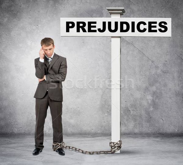 Businessman word prejudice on post sign Stock photo © cherezoff