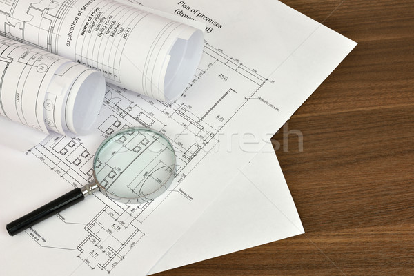 Construction drawings and magnifying glass Stock photo © cherezoff