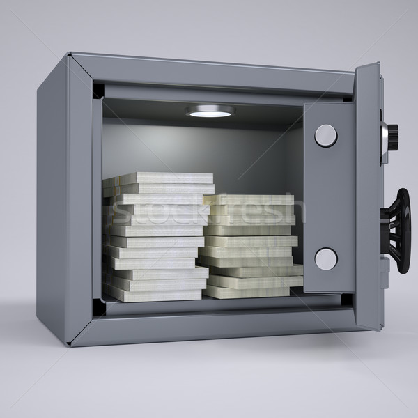 Wads of cash in an open metal safe Stock photo © cherezoff