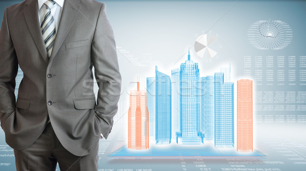 üzletember felhőkarcolók grafikonok áll kezek drót Stock fotó © cherezoff