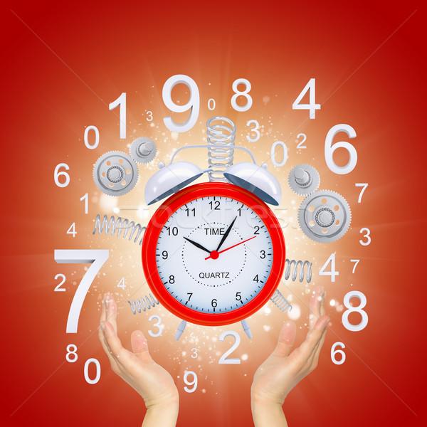 Hands hold alarm clock Stock photo © cherezoff