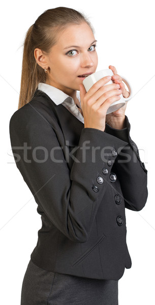 Businesswoman holding mug Stock photo © cherezoff