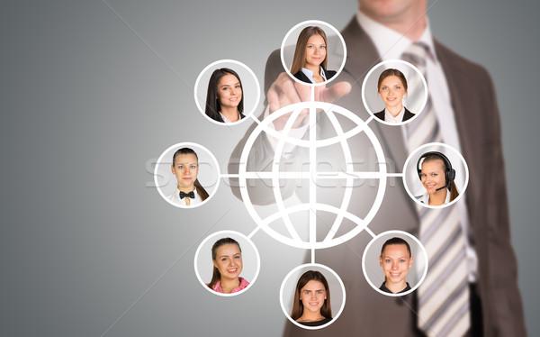üzletember kisajtolás holografikus képernyő nők arcok Stock fotó © cherezoff