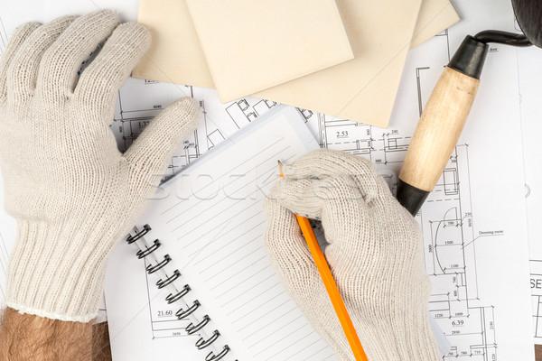 Humans hand writing in pad Stock photo © cherezoff