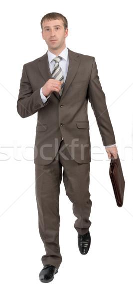 Businessman with suitcase running Stock photo © cherezoff