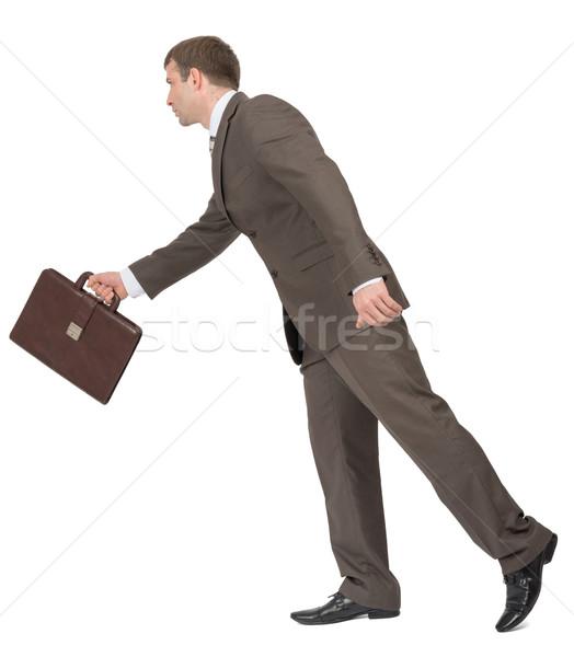 Businessman walking forward, side view Stock photo © cherezoff