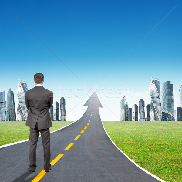 Stock photo: Businessman standing on highway going up as arrow
