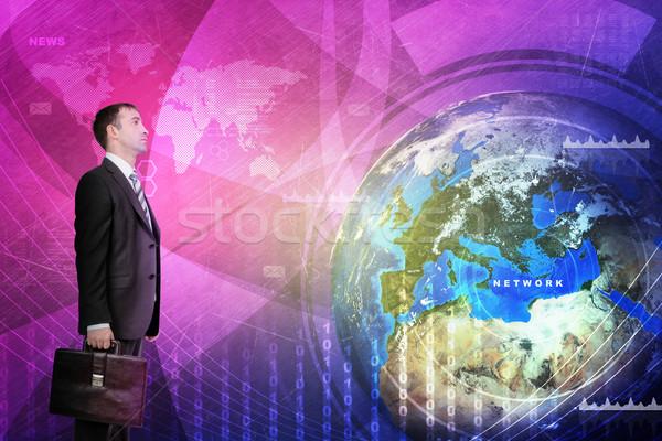 üzletember holografikus képernyő Föld földgömb elemek Stock fotó © cherezoff