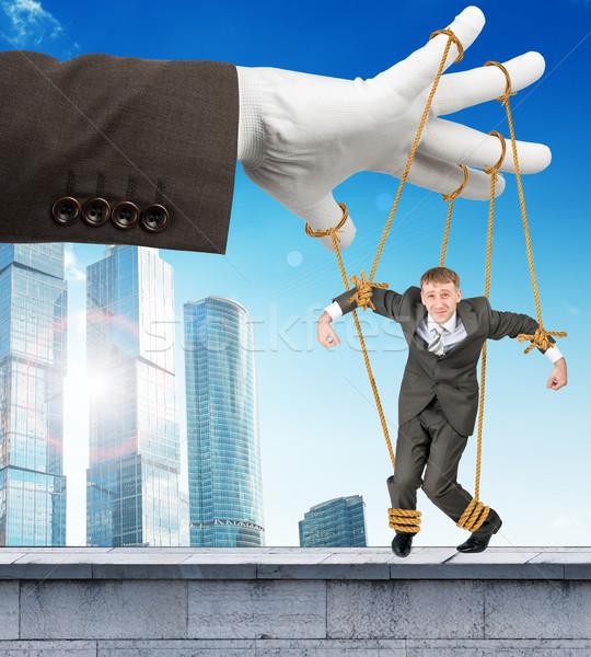 бизнесмен подвесной подобно марионетка изображение фотографии Сток-фото © cherezoff