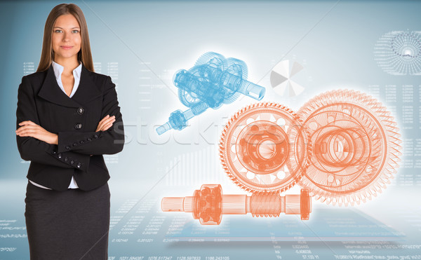 Businesswoman with wire frame gears Stock photo © cherezoff