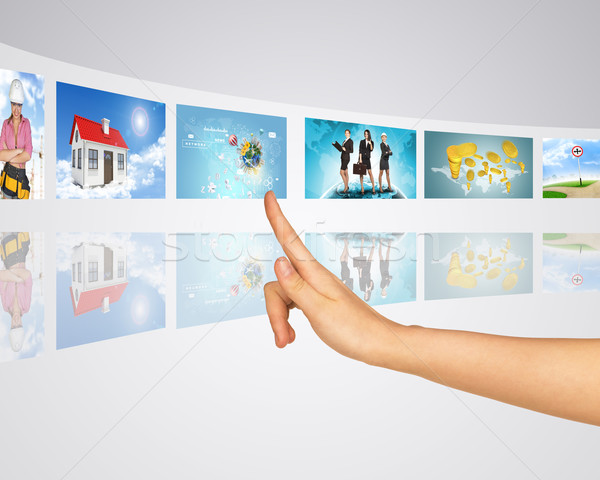 Business lady, home, construction. Finger presses one of virtual screens Stock photo © cherezoff