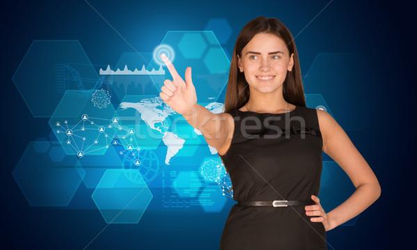 Fiatal nő kisajtolás holografikus képernyő néz ujj Stock fotó © cherezoff