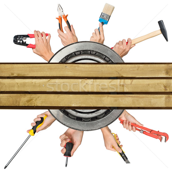 Humans hands holding tools on white Stock photo © cherezoff