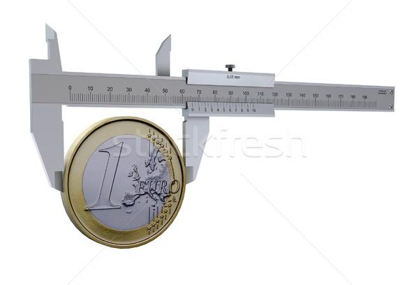 Caliper measures the euro coins. The symbol measures of money Stock photo © cherezoff