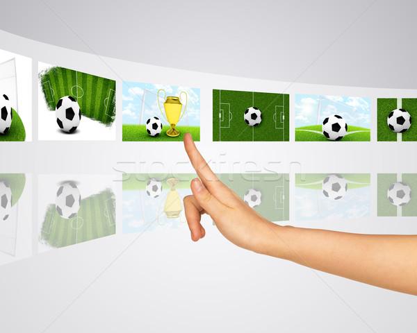 Theme of football wins. Virtual screens Stock photo © cherezoff