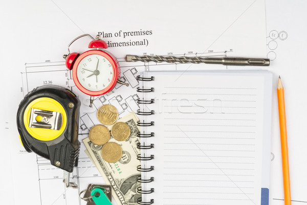 Copybook with drawings and cash Stock photo © cherezoff