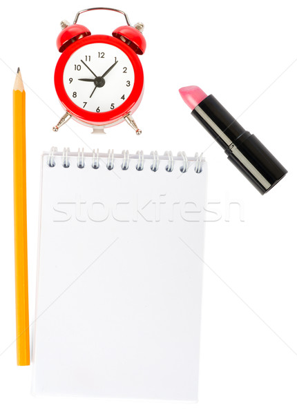 Open copybook with lipstick and alarm clock Stock photo © cherezoff