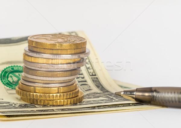 Золотые монеты пер изолированный белый Финансы Сток-фото © cherezoff