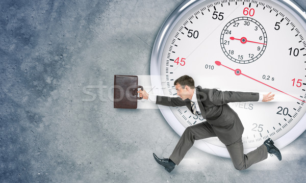 Businessman with big timer Stock photo © cherezoff