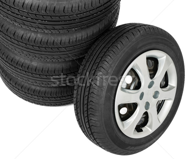 Stack of wheels on white background Stock photo © cherezoff