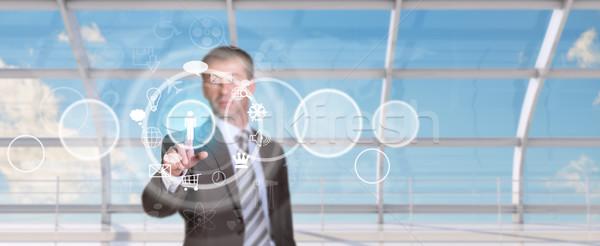 üzletember kisajtolás holografikus képernyő ikonok kör Stock fotó © cherezoff